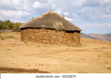 traditional african hut stone and thatch in Lesotho