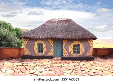 Traditional African painting hut. Basotho tribe village in the South Africa. Exterior of the ethnic rural house. Retro local architecture. African art.
