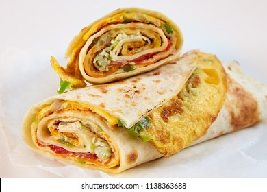 Traditional African rolex rolls with omelette wrapped in chapati flatbread