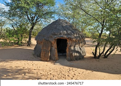 traditional african thatched hut in the Kalahari Desert