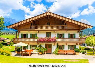 Traditional alpine house in village of Going am Wilden Kaiser on beautiful sunny summer day, Tirol, Austria