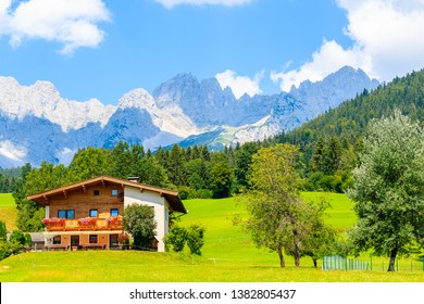 Traditional alpine house in village of Going am Wilden Kaiser on beautiful sunny summer day, Tirol, Austria