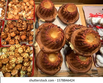 Traditional Alsatian pastry Kouglof with almonds and raisins top view  in the bakery pastry shop in Strasbourg, France