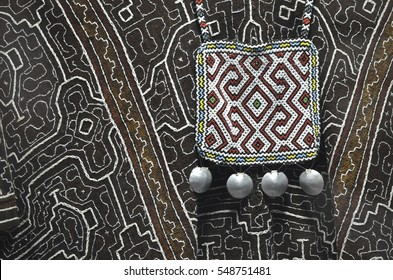 Traditional Amazonian tribal textile patterns and necklaces. Iquitos, Peru.
