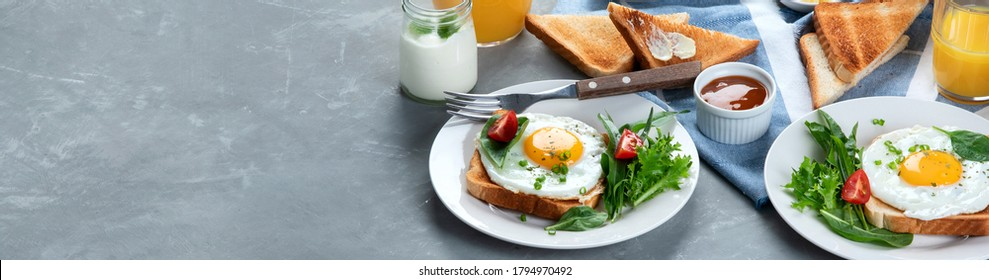 Traditional American breakfast on grey background . Copy space. Panorama, banner.