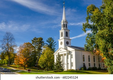 Traditional American White Church with high Steeple under an Autumnal Blue Sky. Williamstown, MA.