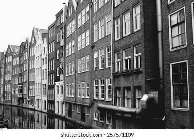 traditional amsterdam old buildings, black and white photo, perspective view