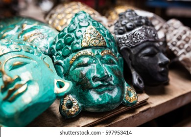 Traditional ancient mask souvenirs and handicrafts of Bali at the famous Ubud Market.
