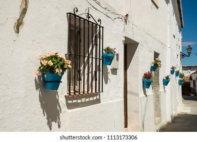 Traditional andalusian village street at Mijas, Malaga, Spain