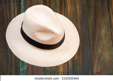 Traditional Antioquian hat - Traditional hat made of the palm of Iraca. Wooden background