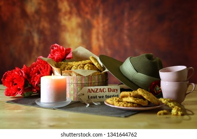 Traditional ANZAC biscuits for ANZAC Day and Remembrance Day in vintage style setting with Australian army slouch hat with copy space.