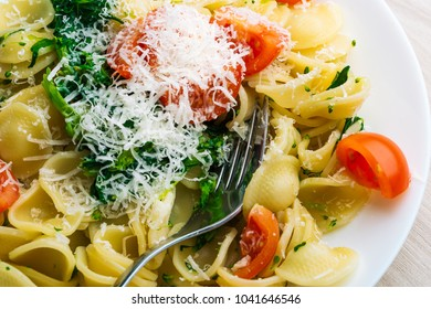 Traditional Apulia region pasta Orecchiette with turnip greens and parmezan, Concept Italian Pasta