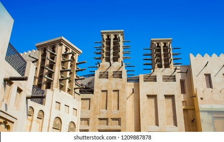 traditional Arab wind tower for air conditioning and cooling on top of building in Dubai, United Arab Emirates