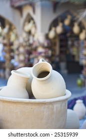 A traditional Arabian market in Nizwa, Oman, with water pots from the renowned village of Bahla.
