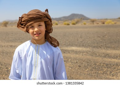Traditional Arabic boy. Culture heritage in modern world. East vs West.