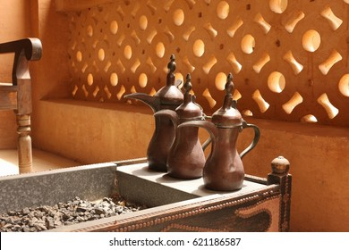 Traditional Arabic Coffee Pots Dallah on an open charcoal brazier, a container for hot coals