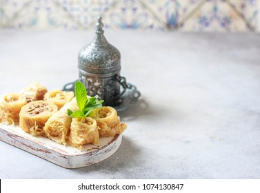Traditional arabic dessert Baklava with honey and nuts. Selective focus