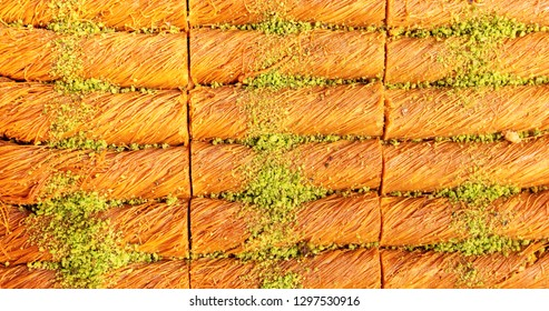 Traditional Arabic dessert Kunafa with pistachio. Background.