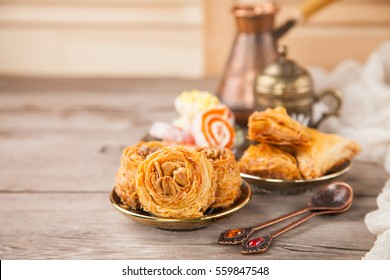 Traditional arabic desserts Kunafa and Baklava with honey and nuts. Selective focus. Copy space.