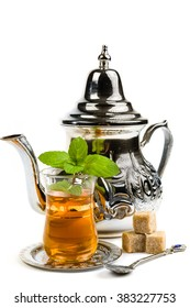 Traditional Arabic mint tea on white background