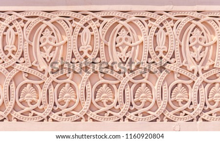 Traditional, arabic style handcrafted stonework pattern on the outer wall for decoration. From Muscat, Oman.