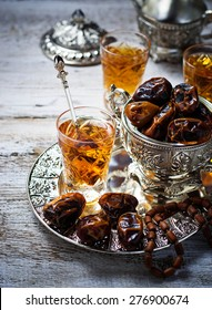 Traditional arabic tea and dry dates. Selective focus. Toned image