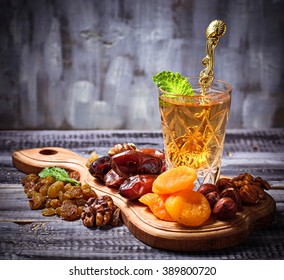 Traditional arabic tea and dry fruits. Selective focus, toned
