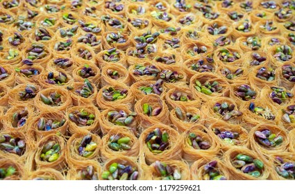 Traditional arabic and turkish sweets pastry dessert baklava with pistachio, sold at local market
