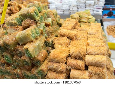 Traditional arabic and turkish sweets pastry dessert kadaif (kunafa, baklava), with pistachio, sold at local market