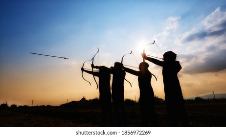 Traditional Archery Practice at the sunset by group