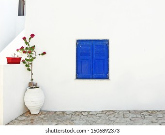 traditional architecture - blue wooden window and bougainvilleas at Ano Koufonisi island Cyclades Greece