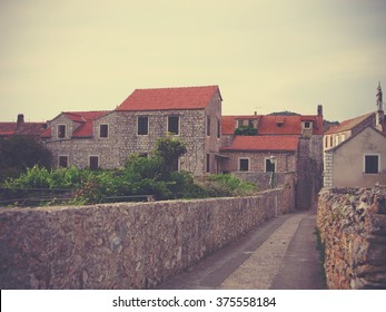 Traditional architecture of the little Croatian seaside town Stari Grad on Hvar island. Image filtered in faded, retro, Instagram style with extremely soft focus; nostalgic, vintage concept of travel.