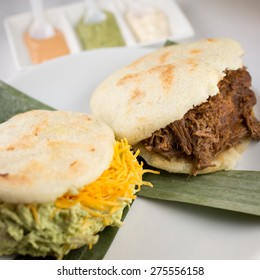 Traditional Arepas. Shredded chicken avocado and cheddar cheese and Carne Mechada, shredded beef.