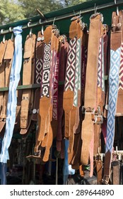 Traditional Argentinean leather gaucho belts hanging on for sale on a fair in Rosario city, Argentina