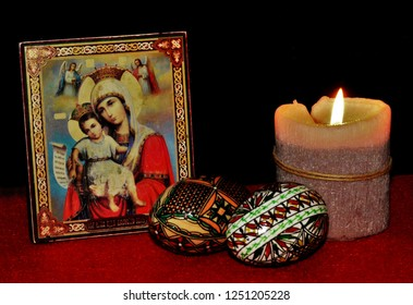 traditional arrangement for Easter with a candle, two eggs and an icon with St. Mary in Voronet - Romania 30.Nov.2018