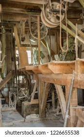 Traditional artisan wooden flour mill equipment, viewed from side and other mill pully equipment, beamed celings very visible