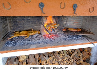 Traditional asado of a whole pork on a typical uruguayan grill with fireplace, Uruguay, South America. Traditional dish in Argentina, Paraguay, Chile and Brazil too.