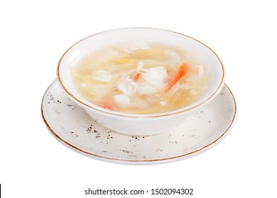 Traditional Asian Crab Meat Asparagus Soup in bowl plate isolated on white background.