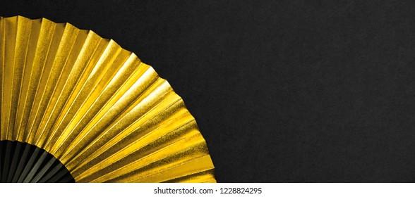 Traditional Asian gold folding fan.   Japan or China.