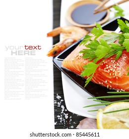 traditional asian ingredients (Fresh salmon steak filet,  ginger, lemon,  soy sause and chopsticks) over white with sample text