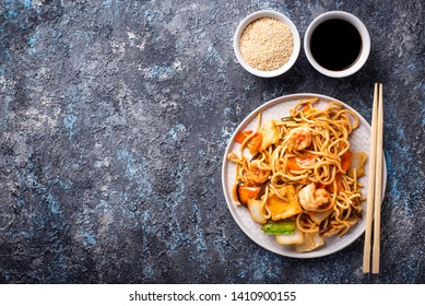 Traditional Asian noodles with shrimps and vegetables. Top view