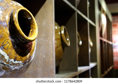 Traditional Asian sake rice wine brewery jugs in shelf (TRANSLATION: NINE)