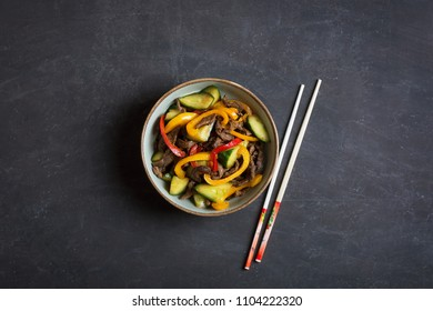 Traditional Asian stir fry salad contains meat and vegetables. Seasoned with soy sauce