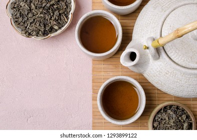 Traditional Asian tea ceremony. Ceramic accessories and dry tea leaves. Selective focus.