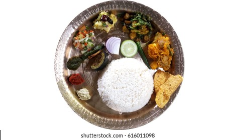 Traditional Assamese thali served in bell metal utensils, food culture of Assam, India.