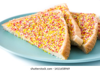 Traditional Australian fairy bread on plate isolated on white background