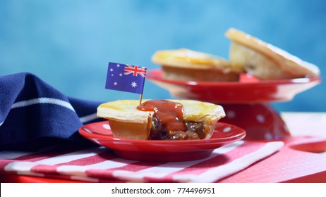 Traditional Australian Meat Pies for Australia or Anzac Day holiday party food, in red, white and blue table setting.