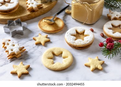 Traditional Austrian Christmas cookies. Linzer Christmas or New Year cookies filled with peanut butter on a marble top.