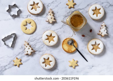 Traditional Austrian Christmas cookies. Linzer Christmas or New Year cookies filled with peanut butter on a marble top. Top view flat lay background.