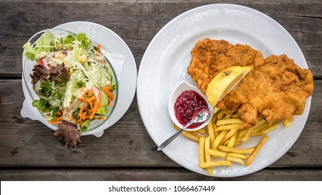 Traditional Austrian food Wienerschnitzel - Fried pork in breadcrumbs
